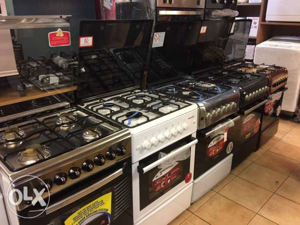 gas oven 4 eyes with one year warranty ( new in box)