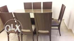 A never used dining table with 8 chairs in good price