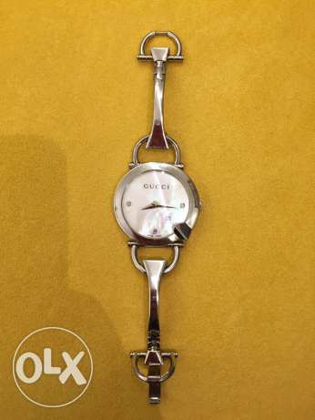 Gucci watch with diamonds and mother of pearl inside