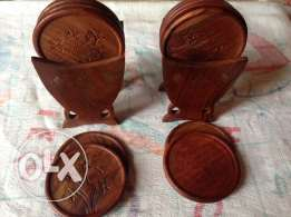 under cup 2 items and wooden box and wooden statues small