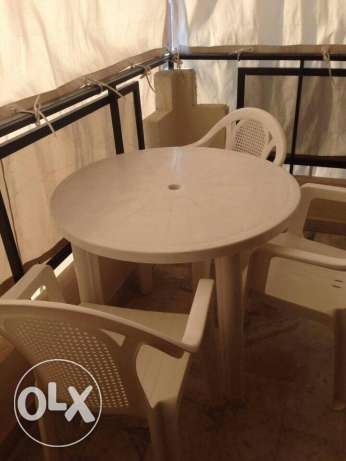 swing table and 3 chairs outdoor