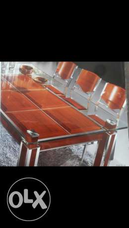 Wooden and Stainless steel Dining tables. Many designs