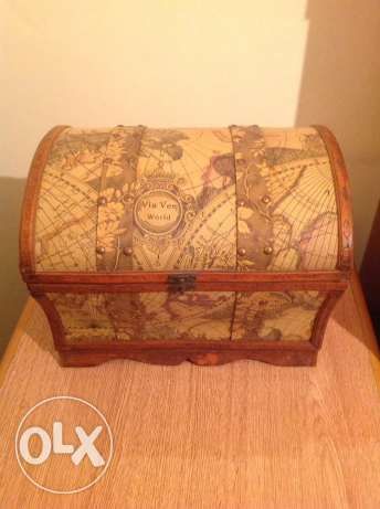 Wooden box with leather