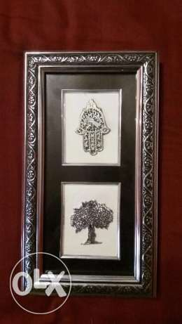 Hand of fatima and tree and camel