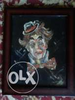 sad clown painting + wooden frame