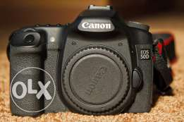 Canon 50D body nly / Charger / 4 batteries