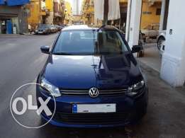 V.W Polo Sedan 1.6L-Mod:2013-Dark Blue/Black-Automatic-1 Owner