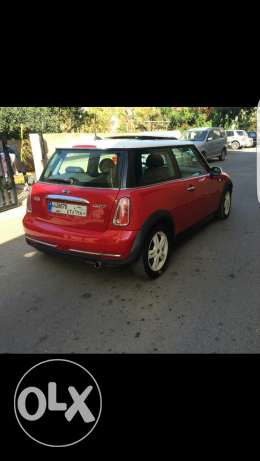 Mini Cooper 2006 red color black leather interior, panoramic sunroof