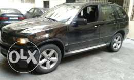 X5 model 2005 3.0 black & black masdar Cherke clean