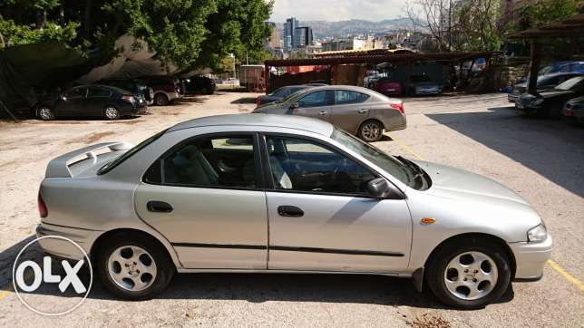 Mazda 323 - Very Clean - yr 1998 - Full Options