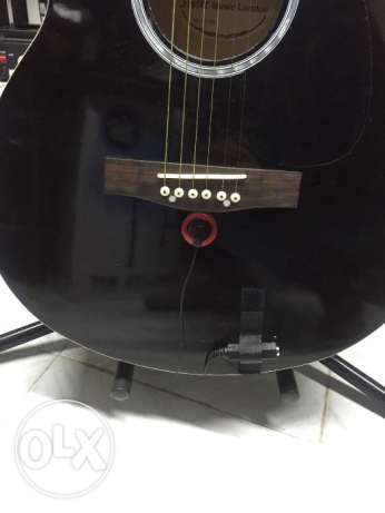 Acoustic guitar pick up for guitar amplifier