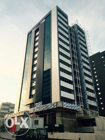 High standards, fire rated, fifteen storey building offering offices and shops. ضبيه -  2
