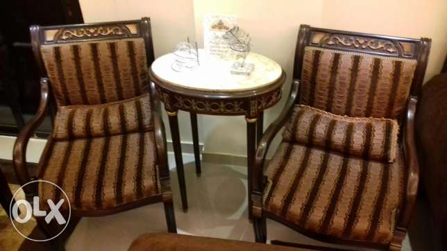 salon with 3 sofas 2 tables 2 chaires and a vitrine
