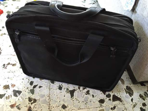 Tumi laptop bag - excellent condition - black -personal usage