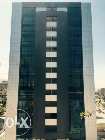 High standards, fire rated, fifteen storey building offering offices and shops. ضبيه -  3