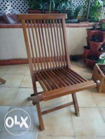 8 Outdoor folding wooden chairs. قرنة الحمرا -  1