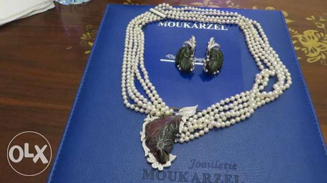 necklace of perle diamond and tourmaline with pendants d oreilles .