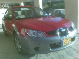 2006 subaru outback sport AWD /vitesse/red color or automatic