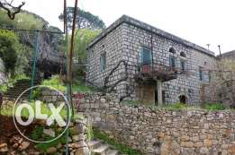Kortada-15 minutes from Monte Verde-old traditional house for sale.