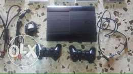 PS3 super slim with 2 original controllers and 4 dvd games