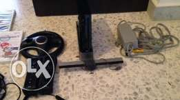 wii for sale with 3 games 2 controller 1 joystick 1 steering weel