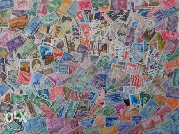 100 different used US stamps