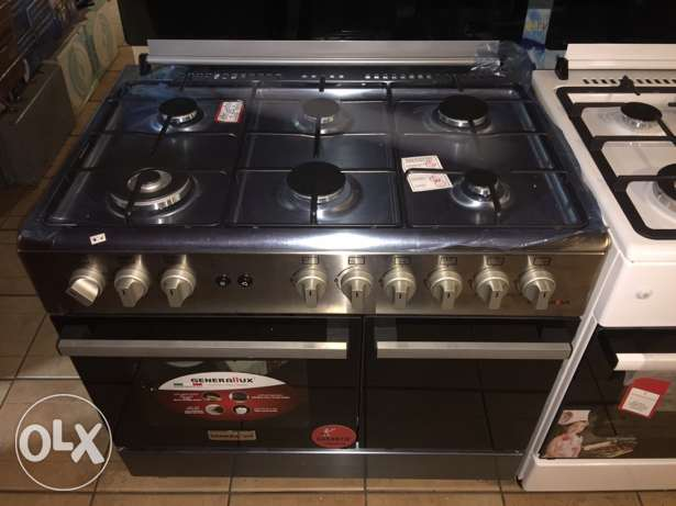 gas oven 6 eyes stainless with one year warranty ( new )