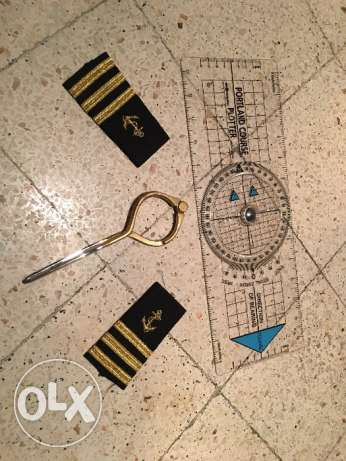 Navigation rule , marine devider , and captain shirt logo . المرفأ -  2