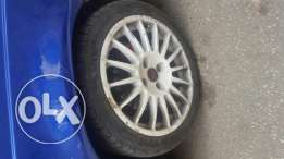 4 O.Z original rims  not made in China  with 3 Marangoni tires made in Italy