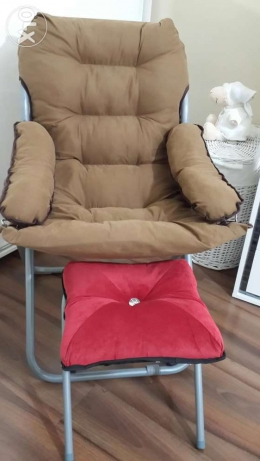 Arm chair with red bouff+vintage stool storage