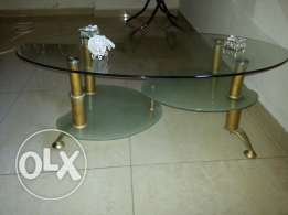 Elegant Glass table with bronze legs