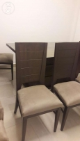 A brand new dining table with 8 chairs