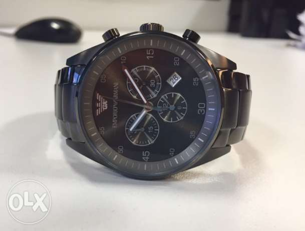 Genuine Emporio Armani Greige on 70% discount