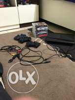 PS3 with 10 games,3 joysticks and a charger