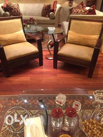 two arm chairs + side table