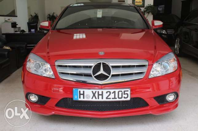 Mercedes c300 model2009 red/blk panoramic 65000 miles new tires