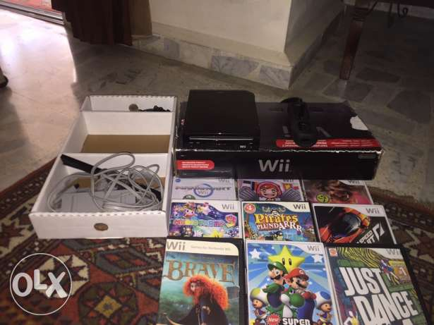 black wii with 9 C.D