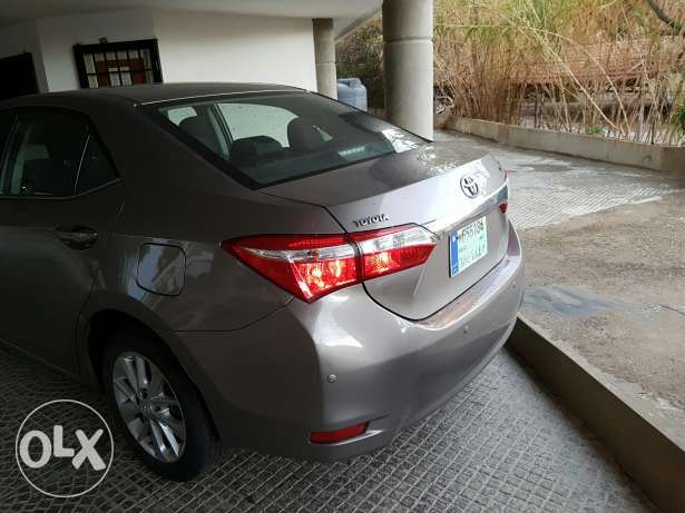 toyota corolla 2014 superior package still under company warranty . حارة حريك -  8