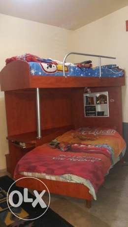 Double bed with desk and stair drawers and closet