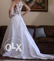 Amazing white lace wedding dress, with unique new design for sale