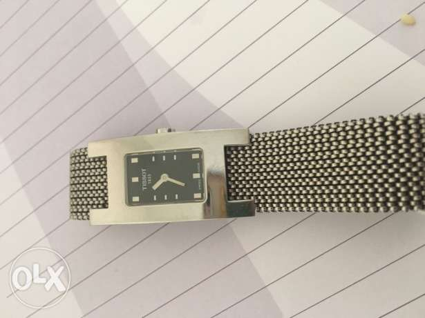 authentic TISSOT watch in silver