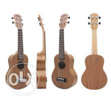 UKELELE guitar all new in box غيتار صغير حشب