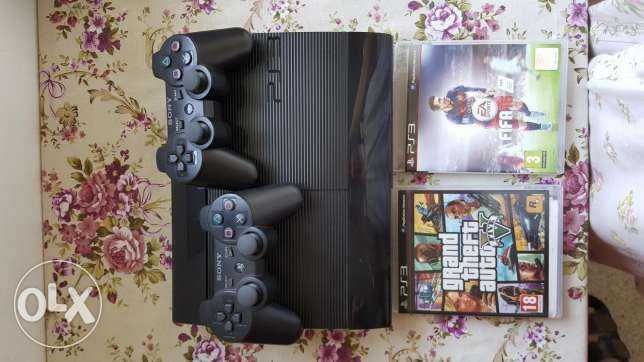 PS3 with 2 games unused with 2 controls