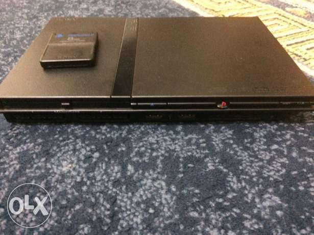 ps2 slim with 40+ cds and a memory card