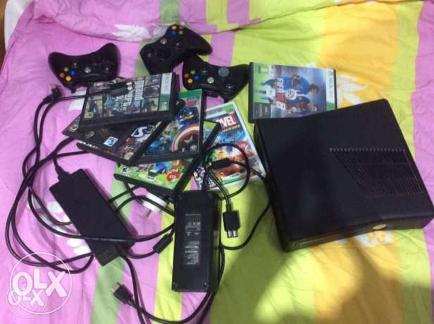 Xbox 360 with 3 controllers and 2 adapters(needs new lens)