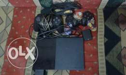 Ps2 new+2 controllers (one canadian wired second wireless)