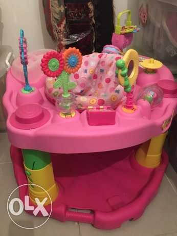 baby evenflo exersaucer in pink