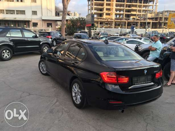 BMW 320 Black 2012 Fully Loaded in Showroom Condition! بوشرية -  4