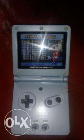 nintendo gameboy advance sp + many built in games (no charge )