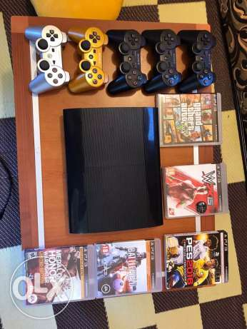Ps3 with 5 controllers ( 2 of them original )